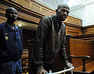 Mngeni, who had surgery in June 2011 to remove a brain tumour, has suffered seizures and blackouts and has trouble remembering things, his lawyer has said. His poor health slowed the trial and he appeared thinner than he had at previous hearings. Mngeni used a walker to enter the court and sat without betraying much emotion during the proceedings, looking straight ahead at the judge as he spoke and a translator offered his words in Xhosa.