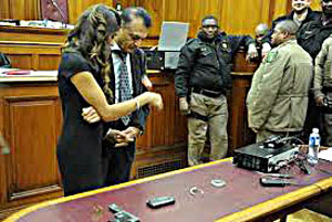 Anni's family look at the stolen items recovered in court.