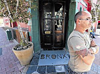 DJ Graig Quinn pictured in front of the entrance to Bronx bar